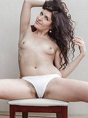 Innocent in white, Rimma S wears stockings and lingerie. She unwinds and spreads her legs to get our attention. She rubs her hands across her hairy pussy and 34A breasts and really has fun in this sexy set.