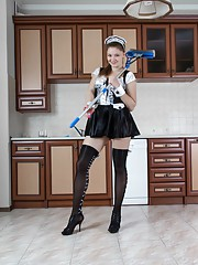 Guyana is dressed as a sexy maid in her outfit and stockings. She lifts her skirt, shows off her hairy its and strips naked. She climbs on the counter, and spreads her hairy pussy lips wide open to enjoy.