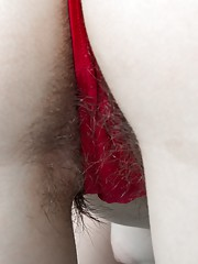 Guyana is in her bedroom with her red top and denim skirt. She shows off her hairy pits early and then strips naked to show a full hairy pussy. She lays across the bed showing off her beautiful hairy body