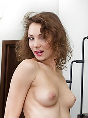 Simona sits on her sofa all innocent and sexy. She slowly plays alone and shows off her hairy pussy midway through. From there, she is all naked, and shows off her petite all-natural body to look sexy.