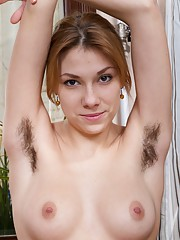 In leggings and a sexy top, Alisia strips naked on the stairs and flexes her all-natural body. Naked, she shows us her hairy legs and hairy pussy which are perfect on her sexy young body to fully enjoy.