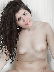 Rimma S loves blue and her blue heels and blue lingerie show that off nicely. After some sexy posing, she moves to the bed and gets naked. Seeing her spread her legs and show off her hairy pussy looks perfect.