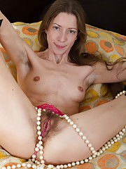 Ryisya dances on her bed and shows off her long slender figure. Early on, she strips naked and shows a very hairy pussy to us. She has a favorite pearl necklace that goes all over her body and is beautiful.