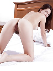 Returning home, Vesta gets out of her dress and strips naked. Not all tired, she strips out of her clothes and shows off her hairy pussy and hairy pits. She rubs her pussy all over the bed and plays there.