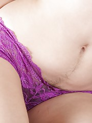 Camille is cleaning in her sexy green dress and wants to relax. She reveals her 34C breasts, then shows her hairy pussy in her purple panties. From then, it