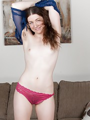Mahonia is a young and hot American all-natural sexy girl, who in her lingerie is hot. She slowly strips off that lingerie and shows her very hairy pussy and fingers her pussy madly to enjoy herself.
