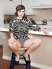 Simone shows off her hairy legs in the kitchen and is in her sexy zebra dress. She strips naked and gives us a view of her hairy pits and pussy. Eating a banana at the end. she eats naked and looks amazing.