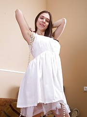 Agneta looks beautiful in her white dress and red heels. She spreads her legs and by picture 15 we see her hairy pussy. She slowly gets naked and shows off her all-natural body and fingering herself with joy.
