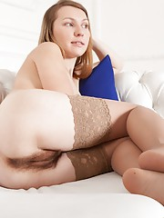Stella is a young Russian student, and has sexy legs covered in stockings. Her purple panties cover her hairy pussy and she is very beautiful. She rubs her hairy pussy good and looks breathtaking here.