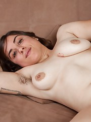 Mercedez shows off her body and hairy pits and is charming. She has 36C breasts flowing from her body. When she strips naked, her very hairy pussy and pink pussy lips flow from in between her young legs.