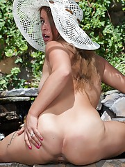In her garden, Bunny loves to wear sexy outfits and masturbates. She strips naked, fondles her 32D breasts and rubs her hairy pussy. She uses the hose and shoots water at her hairy cunt and is so hot.