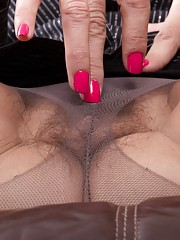 Gina Louise is a mature & busty all-natural beauty. She spreads her legs in her stockings & shows her hairy pussy underneath. Undressing completely her body is amazing & her pink pussy is moist & hot.