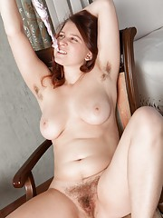 By her window, Lena Lake reads by the water. She wants to be naked, and strips to show off her hairy pits and sexy body. Her beautiful young Russian body poses by the window and her hairy pussy shines here.