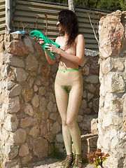Outdoors, Ramira is a sexy teen Russian. She finds a quiet spot and strips down topless with her stockings on. As the stockings come off, she shows off a slender figure and hairy pussy which is great.