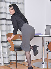 Raven haired secretary with a plump round ass fondles her throbbing clit