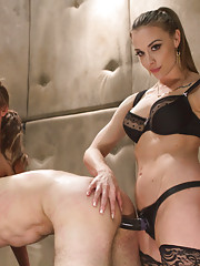 Tough muscle bitch and her hot friend dominate slave with her big muscles and strap-on cock.